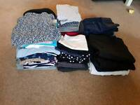 Large bundle of maternity clothes