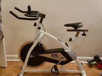 Indoor exercise bike with wheel resistance