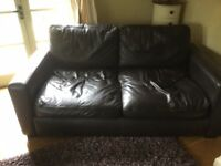 Dark brown small leather sofa.