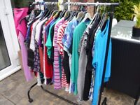 WOMEN'S TOPS. AT LEAST 50 TO CHOOSE FROM. ALL SIZE 12 OR 14. MAINLY M & S.
