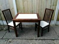 Mahogany table and pair of matching chairs