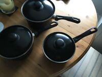 Set of black saucepans- good condition