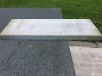Concrete wall cappings.