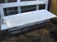 old cast iron bath may suit horse cattle trough