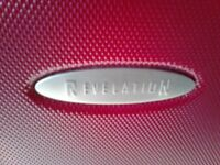 2 X RED HARDSHELL SUITCASES MAKE OF CASE IS REVELATION