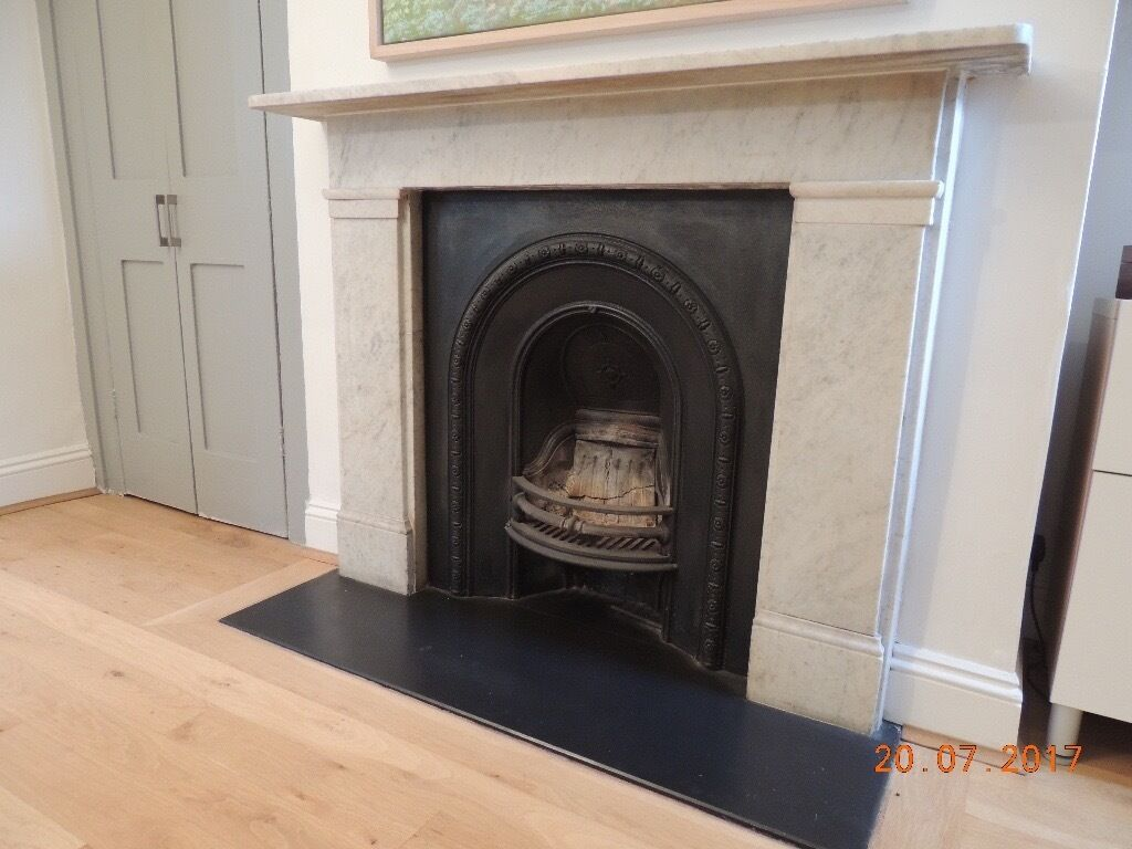 marble fireplace with slate hearth in archway