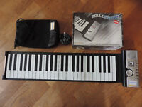 Roll Up Piano with carrying case.