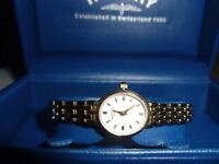 ROTARY LADIES QUATZ WATCH WITH A GOLDPLATED BRACELET STRAP IN EXCELLENT CONDITION