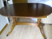 Extending mahogany dining table and 4 matching chairs,excellent condition.