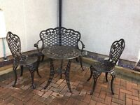 Garden black cast iron effect table; chairs & bench