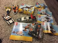 Assorted Lego sets - boats, planes and automobiles.