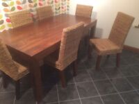 Dining Table and 6 chairs. Table comfortably seats 8. Bought from Next. Mango Wood