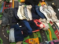 Mix of newborn and 0-3 month baby boy clothes
