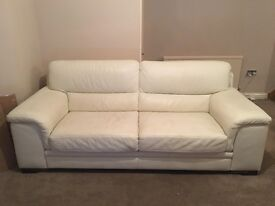 Cream leather three piece suite, including sofa, chair and footstool