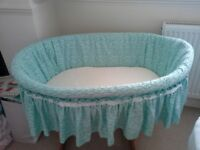 Twin/large moses basket and base. Includes organic cotton mattress covers and fitted sheets.