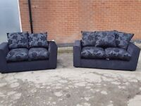 Cute sofa suite. Brand New. Unused. 3 and 2 seater black fabric sofas. Can deliver