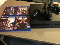 PlayStation 4 with controllers and 4 games