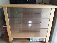 Stainless steel storage unit with wooden worktop