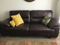 2 identical three seater oak furniture land leather sofas for sale