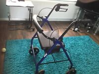 Four wheeled mobility rollator