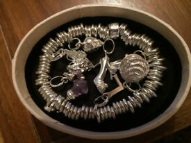 Silver Pandora Sweetie bracelet with 9 charms