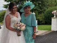 Turquoise sparkly dress with cape sleeves and matching hat
