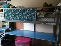 Toy story bunkbed desk combo.
