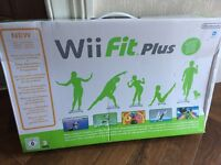 Wii console with Wii fit board nunchucks and many games