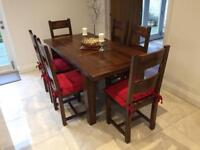 Dark solid wood table and chairs