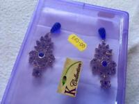 Indian ladies earing brand new £5