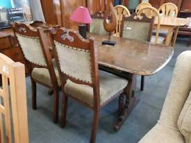 wooden table with 4 fabric cushioned chairs