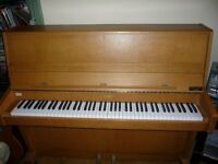 Zender upright piano. 85keys . On castors well maintained.
