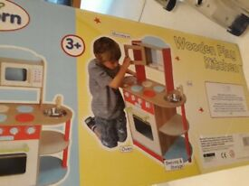 Wooden play kitchen. Still in box.