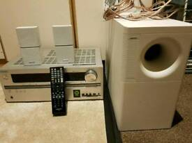 Onkyo amplifier with bose satellite speaker and subwoofer