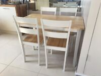 Table and 4 chairs in a good condition