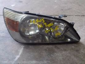 Lexus IS 200 drivers headlight