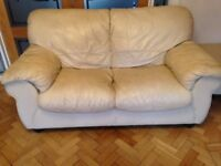 Free , well used 3+2 seater sofa ,cream leather