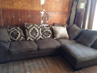 Comfortable sofa with feather pillows