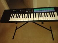 Electric Keyboard with mains adapter and stand