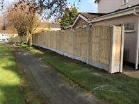 Bow top pressure treated vertical board fence panels