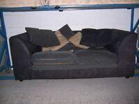 Black and grey sofa (damaged) at Cambridge Re-Use (cambridge reuse)