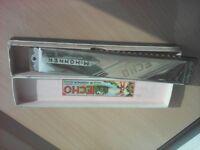 M Hohner echo harmonica