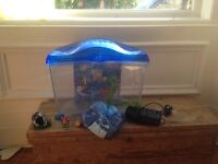 Fish tank with filter, ornaments and gravel.