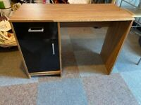 Black and dark brown wooden desk, with two drawers