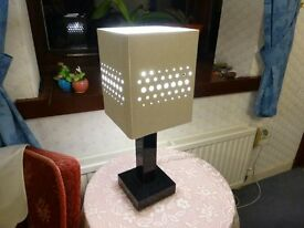 Very attractive lamp with black base and 4 sided shade with punched hole design