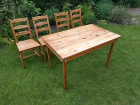 "Ikea 'Jokkmokk"" dining table and 4 chairs."