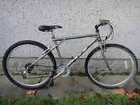 GT outpost retro mountain bike 26 inch wheels, 21 gears, 18 inch frame silver as new