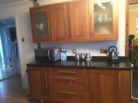 Walnut wood kitchen units