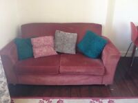 Two seat red sofa