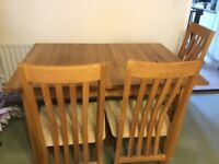 corndell nimbus solid oak dining table with four oak chairs